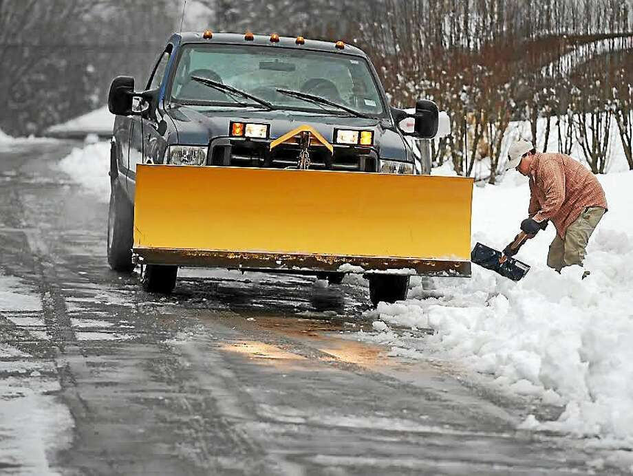 A plow clears a street in Greater New Haven. Photo: (Peter Hvizdak — New Haven Register) / ©2015 Peter Hvizdak