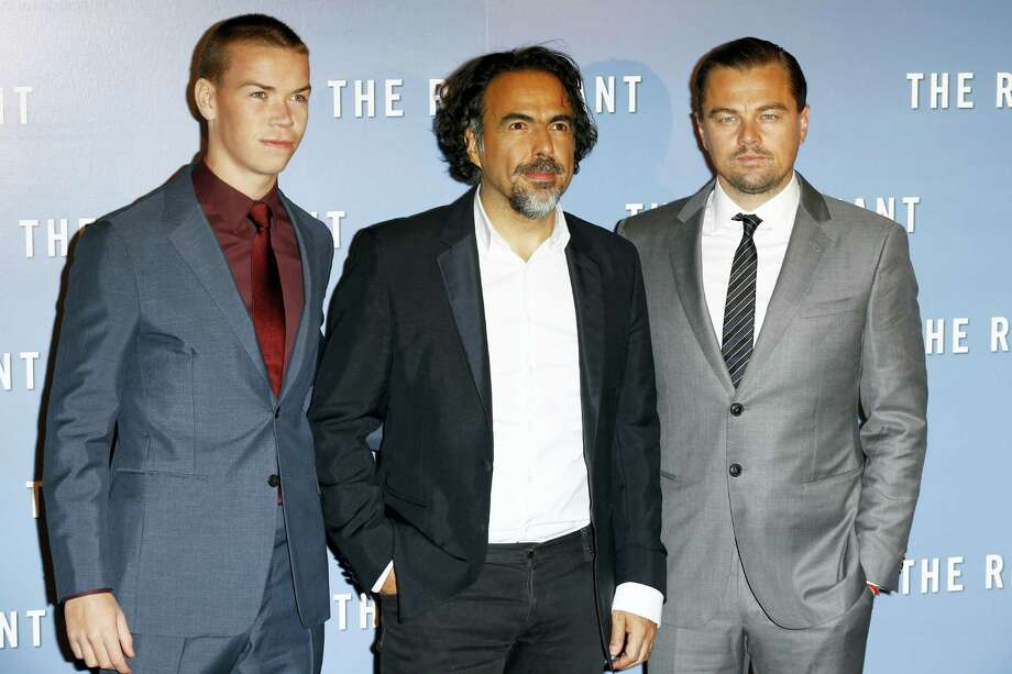 """British actor Will Poulter,  Mexican director Alejandro Gonzalez Inarritu, and actor Leonardo Di Caprio, from left to right, pose during a photocall for """"The Revenant"""", in Paris, France on Jan. 18, 2016. Photo: AP Photo/Francois Mori  / AP"""