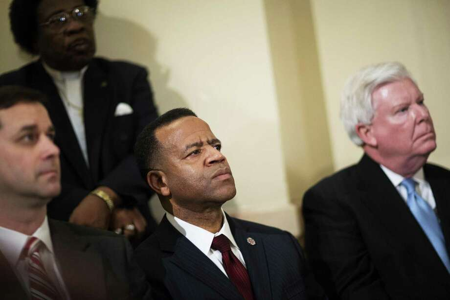 FILE- In this Jan. 13, 2015 file photo, Former Atlanta fire chief Kelvin Cochran, second from left, listens during a rally by religious groups supporting Cochran following his termination, Tuesday, Jan. 13, 2015, in Atlanta. Even as the U.S. Supreme Court gets ready to decide whether gay couples can marry, lawmakers in the South and West are doubling down on the culture wars, backing longshot legislation targeting gay rights. In Georgia, the debate flared this month when Atlanta Mayor Kasim Reed fired the cityís fire chief after learning the chief self-published a book describing homosexuality as a perversion. Reed, a Democrat, said Cochran never got city permission to publish the book, but Cochran said he did. (AP Photo/David Goldman) Photo: AP / AP
