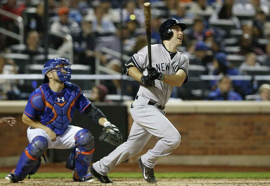 Dustin Ackley hits a sixth-inning, three-run home run during Sunday's game at Citi Field. Photo: Kathy Willens — The Associated Press  / AP