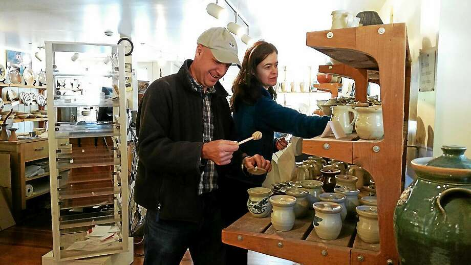 Husband and wife Brian and Caroline Nurenberg of Cornwall shop at the Cornwall Bridge Pottery Store at 415 Sharon-Goshen Turnpike in West Cornwall on Saturday afternoon. The sale and exhibition run also Sunday and Monday from 11 a.m. to 5 p.m. Photo: N.f. Ambery — SPECIAL TO THE Register Citizen