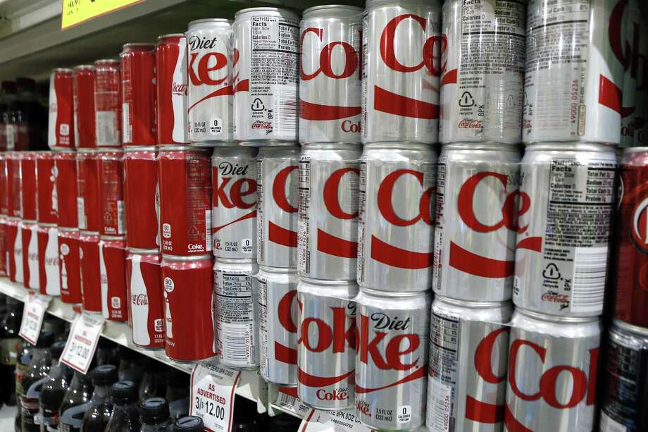 Keith Srakocic — The Associated Press Smaller than the standard 12-ounce size, 7.5-ounce cans of soft drinks are for sale on the shelves in a grocery store in Harmony, Pa. Photo: AP / AP