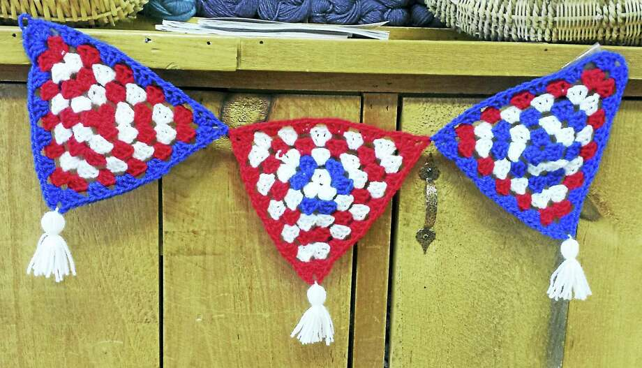 Photo by Ginger BalchGranny squares with a patriotic theme. Photo: Journal Register Co.