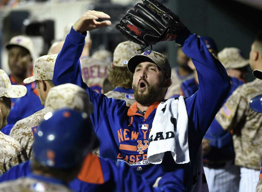 Jonathon Niese and the Mets were pumped to get a 4-0 win over the Atlanta Braves on Monday night in New York. Photo: Kathy Kmonicek — The Associated Press  / FR170189 AP