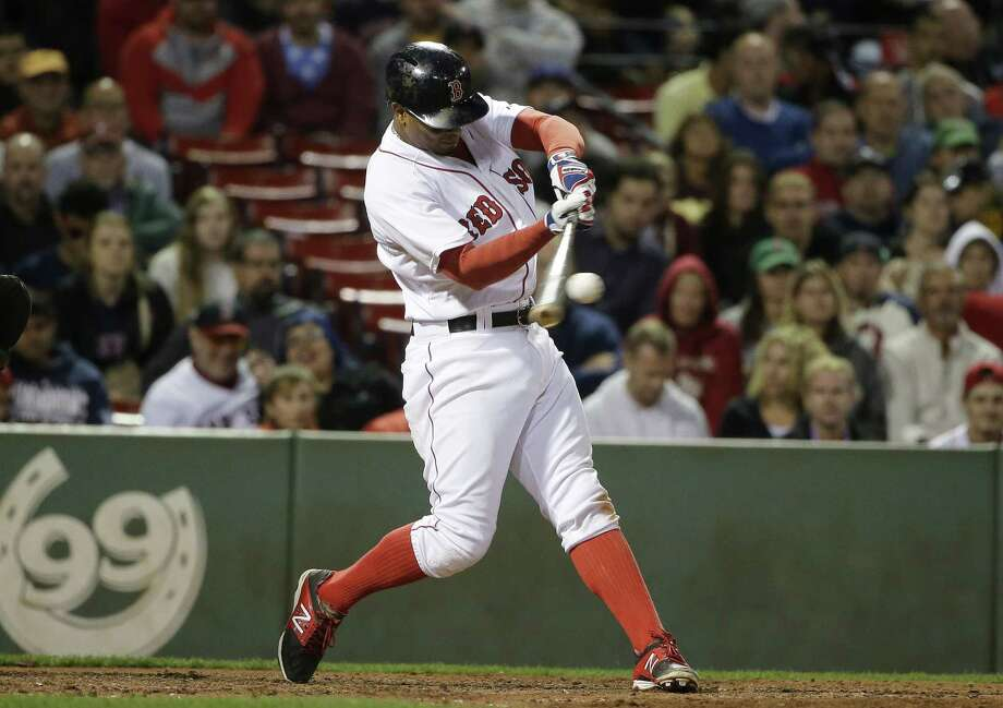 Boston's Xander Bogaerts hits an RBI double in the seventh inning of the Red Sox's 8-7 win over the Tampa Bay Rays on Monday at Fenway Park. Photo: Steven Senne — The Associated Press  / AP