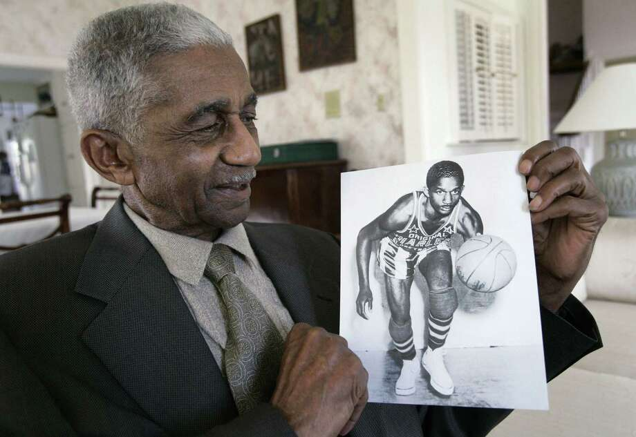 In this Feb. 14, 2008 file photo, former Harlem Globetrotters great Marques Haynes holds a photo circa 1951 of himself in his Globetrotters uniform. Haynes died Friday in Plano, Texas. He was 89. Photo: Tony Gutierrez — The Associated Press File Photo  / AP