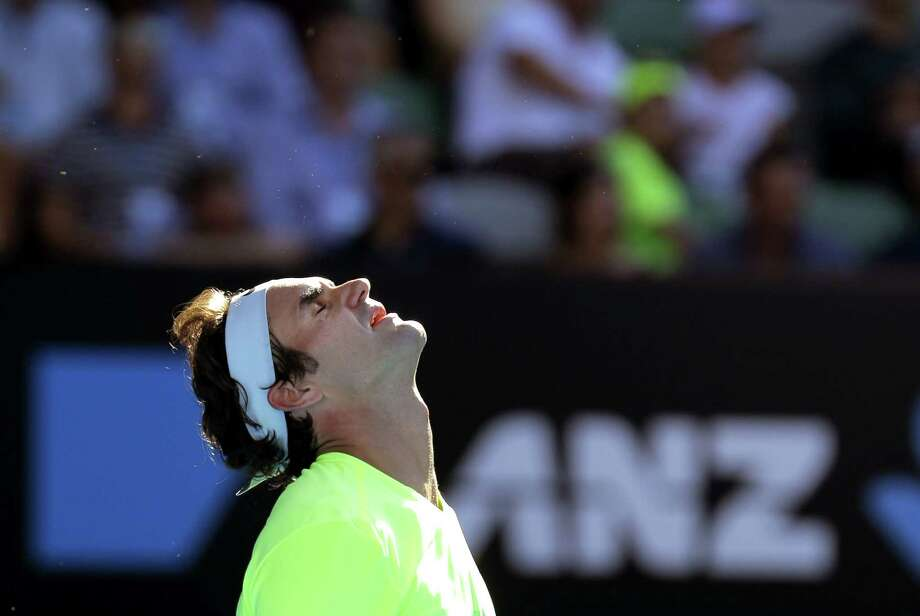 Roger Federer reacts as he plays Andreas Seppi during their third-round match at the Australian Open on Friday in Melbourne. Photo: Bernat Armangue — The Associated Press  / AP