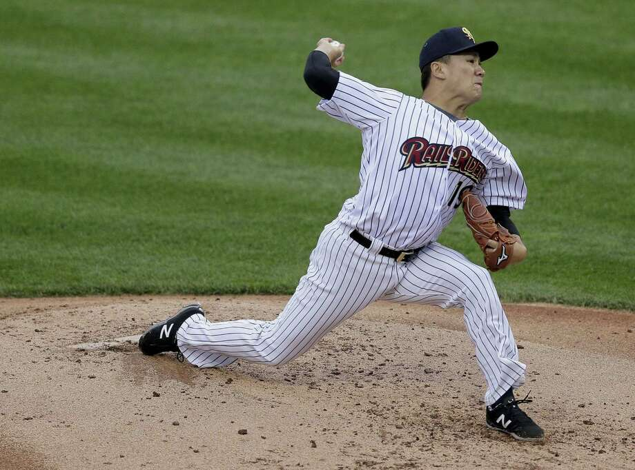 New York Yankees pitcher Masahiro Tanaka, playing for the Triple A Scranton/Wilkes-Barre RailRiders, delivers against the Durham Bulls on Thursday in Scranton, Pa. Photo: Julie Jacobson — The Associated Press  / AP