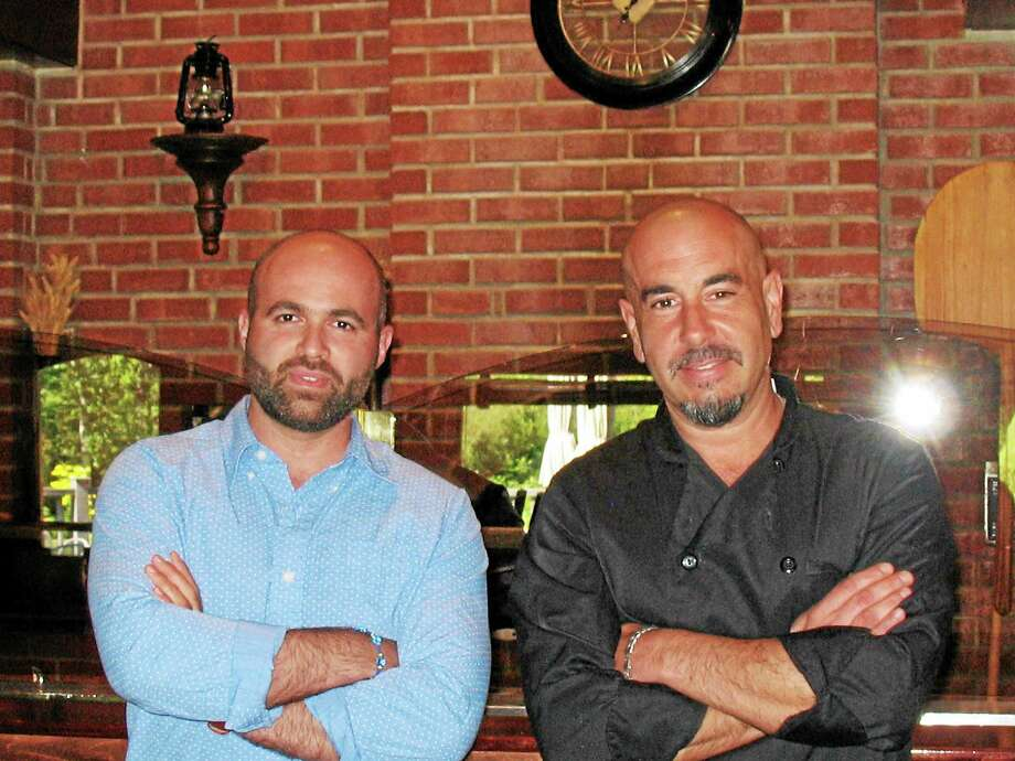 Photo by Katelyn Peterson Da Capo manager Yanni Gogo and new head chef Roberto Pizzo. Photo: Journal Register Co.
