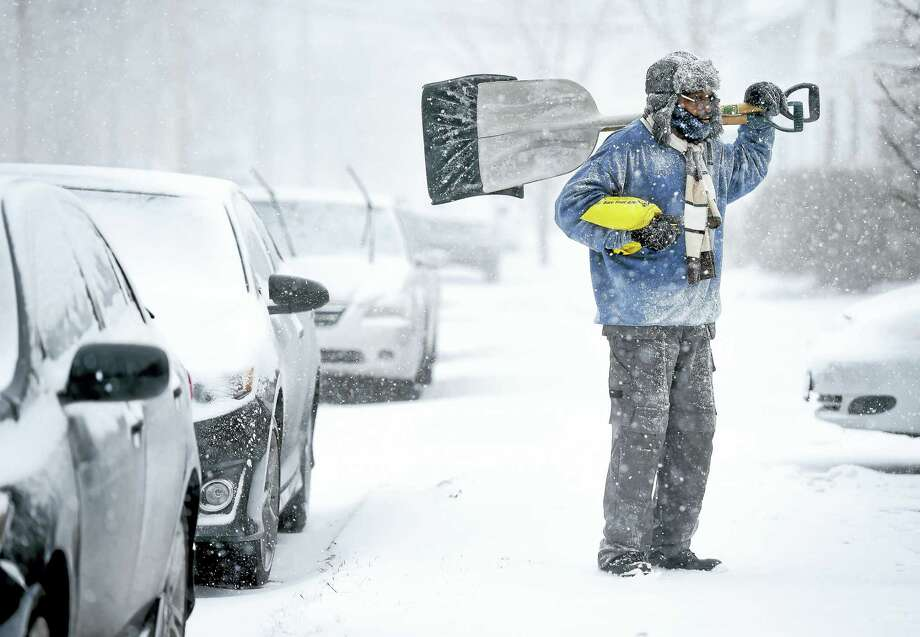 Jessie Frazier looks for shoveling customers with James Lamb (not in photo) in West Haven on 1/23/2016. Photo: Arnold Gold-New Haven Register