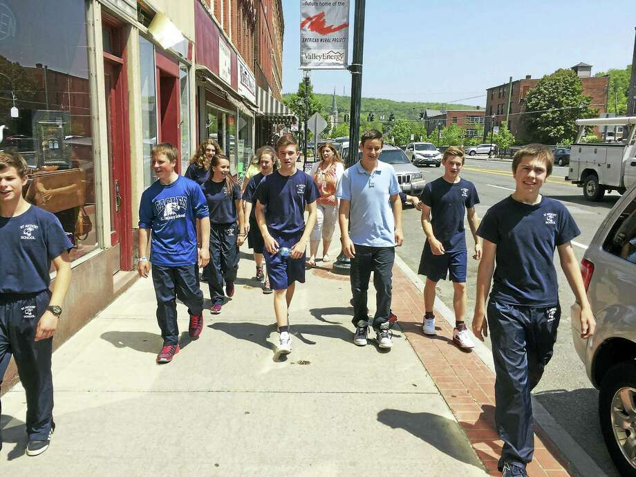 PHOTO BY BEN LAMBERT  Eighth-grade students from St. Anthony School walk through downtown Winsted on their way to the American Museum of Tort Law. Photo: Journal Register Co.