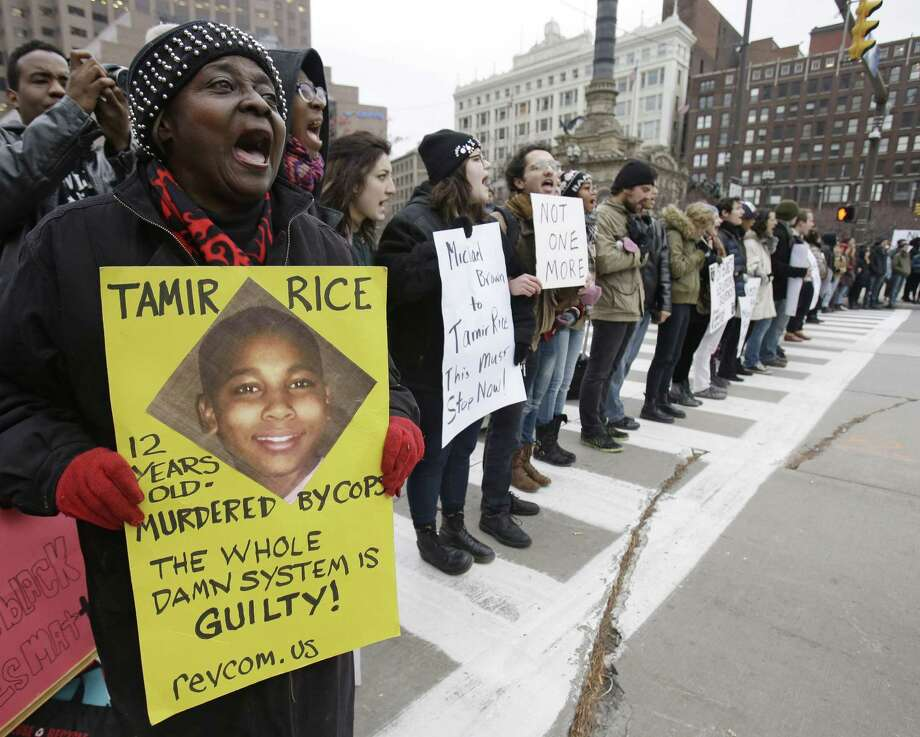 FILE- In this Nov. 25, 2014, file photo, demonstrators block Public Square Tuesday, Nov. 25, 2014, in Cleveland, during a protest over the police shooting of  12-year-old Tamir Rice. Clevelandís politicians and community leaders are now working to make sure protests remain peaceful as the city awaits a verdict in the trial of a white officer in the deaths of the two unarmed people and a decision on whether charges will be filed in Rice's death. (AP Photo/Tony Dejak, File) Photo: AP / AP