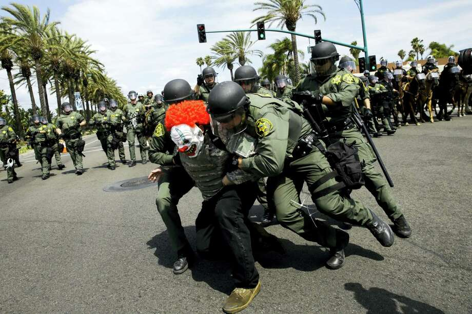 Orange County Sheriff's deputies take a protester into custody outside the Anaheim Convention Center where Republican presidential candidate Donald Trump held a rally, Wednesday, May 25, 2016, in Anaheim, Calif. Photo: AP Photo — Jae C. Hong / Copyright 2016 The Associated Press. All rights reserved. This material may not be published, broadcast, rewritten or redistribu