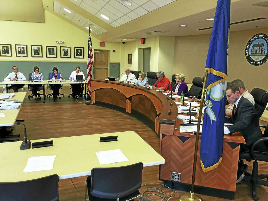BEN LAMBERT — REGISTER CITIZEN The Board of Finance Wednesday discussed the projected tax rate for the coming fiscal year and approved measures to address an expected overrun in the school budget. Photo: Journal Register Co.