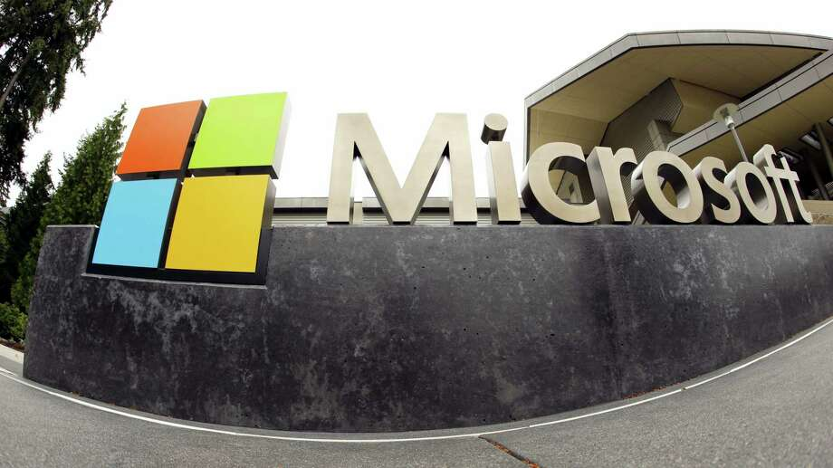 The Microsoft Corp. logo outside the Microsoft Visitor Center in Redmond, Wash. Microsoft announced May 25, 2016 it is cutting jobs, as the company continues its attempts to salvage a rocky entrance into the smartphone market. Photo: AP Photo Ted S. Warren, File  / AP