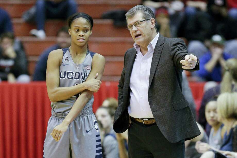 UConn coach Geno Auriemma, right, speaks with Moriah Jefferson during a game earlier this season. Photo: John Minchillo — The Associated Press  / AP
