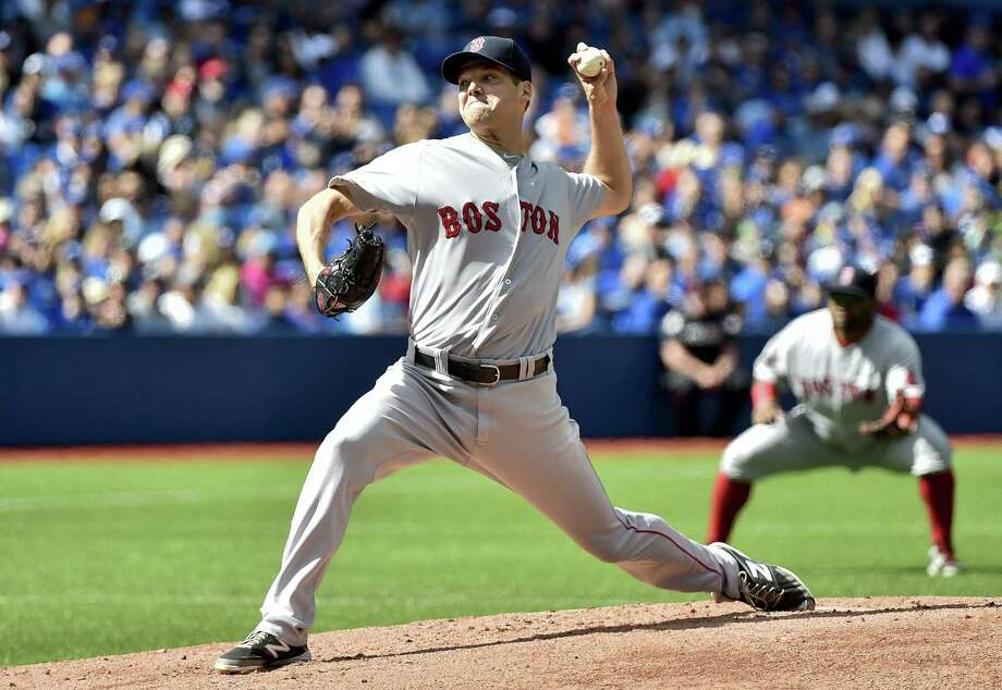 Red Sox starting pitcher Rich Hill works against the Blue Jays in the first inning on Sunday. Photo: Nathan Denette — The Canadian Press Via AP  / The Canadian Press