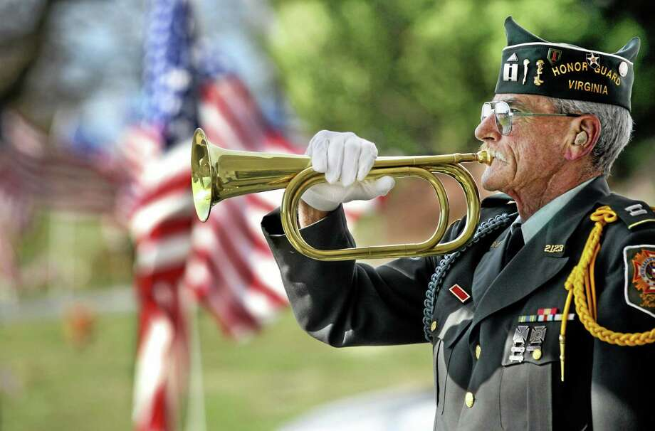 "Veterans of Foreign Wars Post 2123 Honor Guard member Ed Ellis plays ""Taps"" in this 2013 file photo. Photo: AP FILE PHOTO  / THE WINCHESTER STAR"