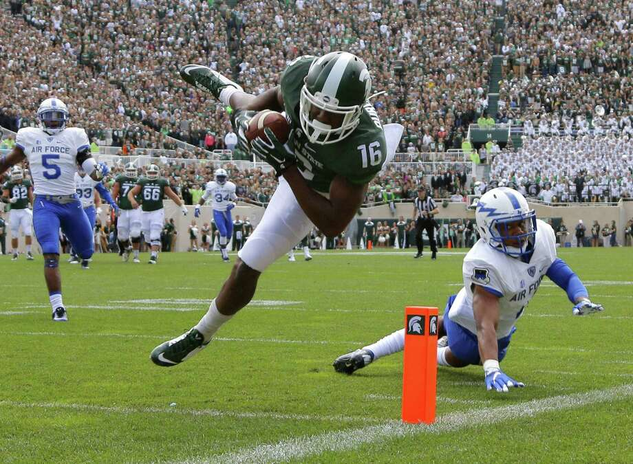 Wide receiver Aaron Burbridge and Michigan State moved up to No. 2 in the AP Top 25 poll. Photo: The Associated Press  / FR11125 AP