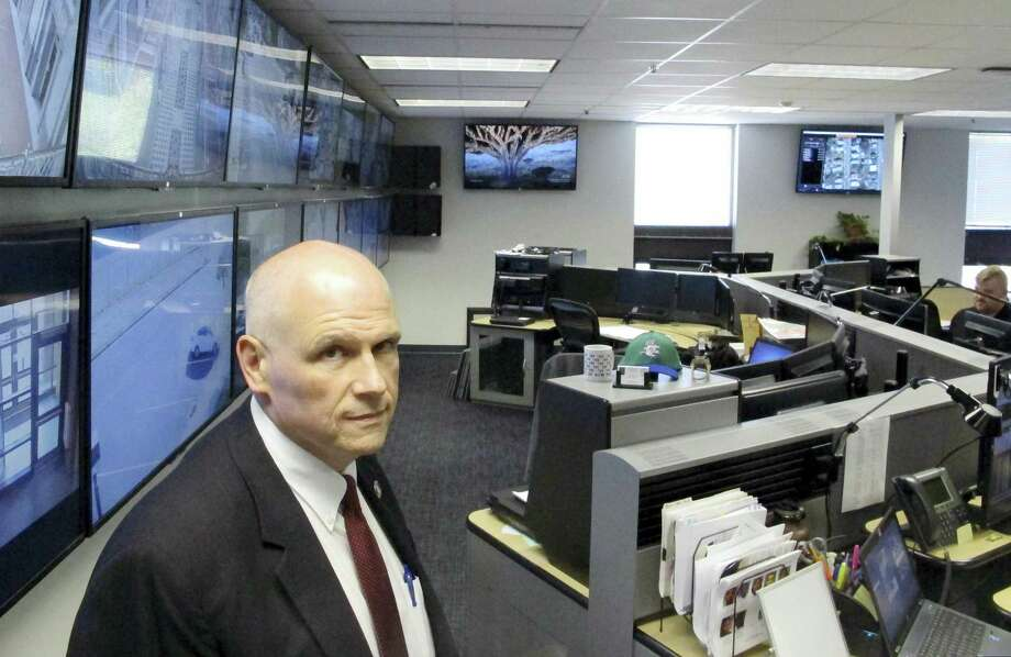 Hartford Police Chief James Rovella poses at the police department's Real-Time Crime and Data Intelligence Center in Hartford. Staff at the center analyze data from surveillance cameras, gunshot detectors, license plate scanners and other sources. Such facilities are proliferating nationwide with the expanded use of surveillance technology, raising some concerns from civil liberties advocates. Photo: AP Photo — Dave Collins  / Copyright 2016 The Associated Press. All rights reserved. This material may not be published, broadcast, rewritten or redistribu