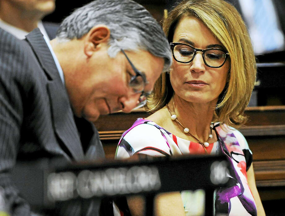 State Sen. Len Fasano, R-North Haven, left, leans in to listen to House Minority Leader Themis Klarides, R-Derby, as Gov. Dannel P. Malloy delivers his budget address to the senate and house inside the Hall of the House at the state Capitol Feb. 3, 2016 in Hartford. Photo: AP Photo — Jessica Hill  / AP2016