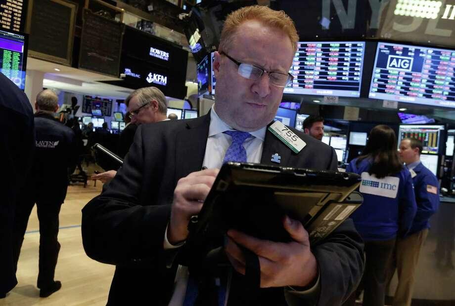 Trader Daniel Ryan works on the floor of the New York Stock Exchange Friday. Photo: Richard Drew — The Associated Press  / AP