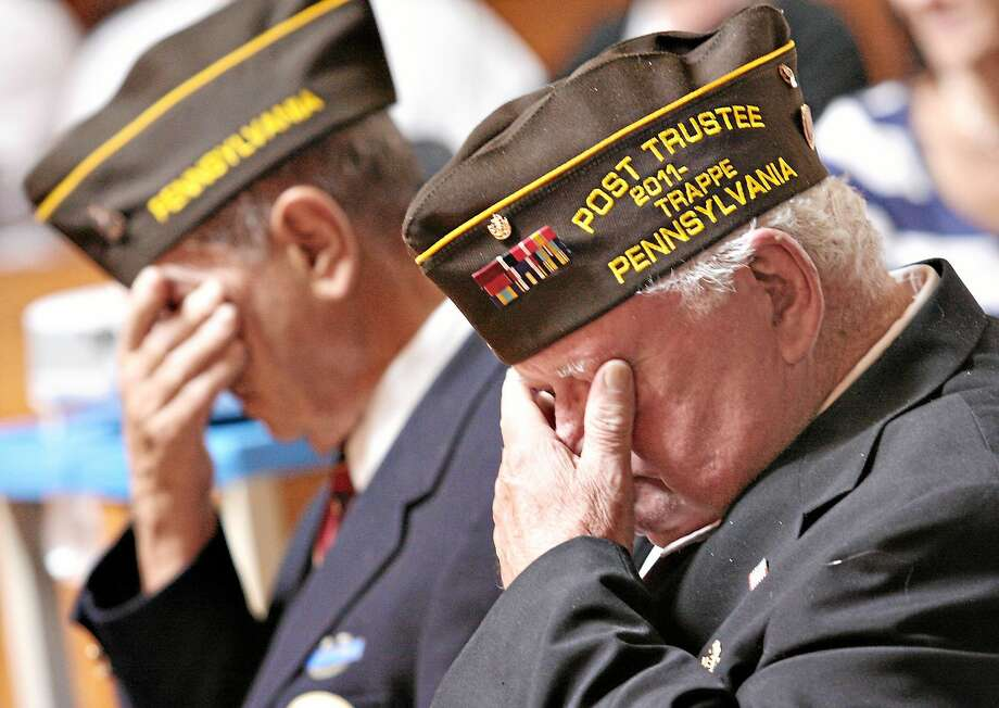 Local veterans wipe away tears as they remember their fallen comrades during a Memorial Day Remembrance service in Schwenksville, Pa. Photo: Digital First Media File Photo