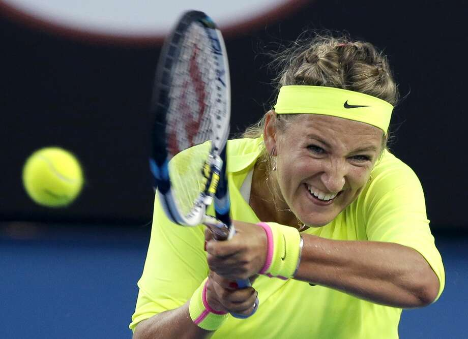Victoria Azarenka makes a backhand return to Caroline Wozniacki during their second-round match at the Australian Open on Thursday in Melbourne. Photo: Lee Jin-man — The Associated Press  / AP