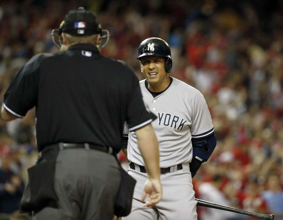 New York Yankees designated hitter Alex Rodriguez looks at home plate umpire Marvin Hudson (51) after making the last out on a called third strike against the Washington Nationals. The Nationals won 3-2. Photo: Alex Brandon  — The Associated Press  / AP