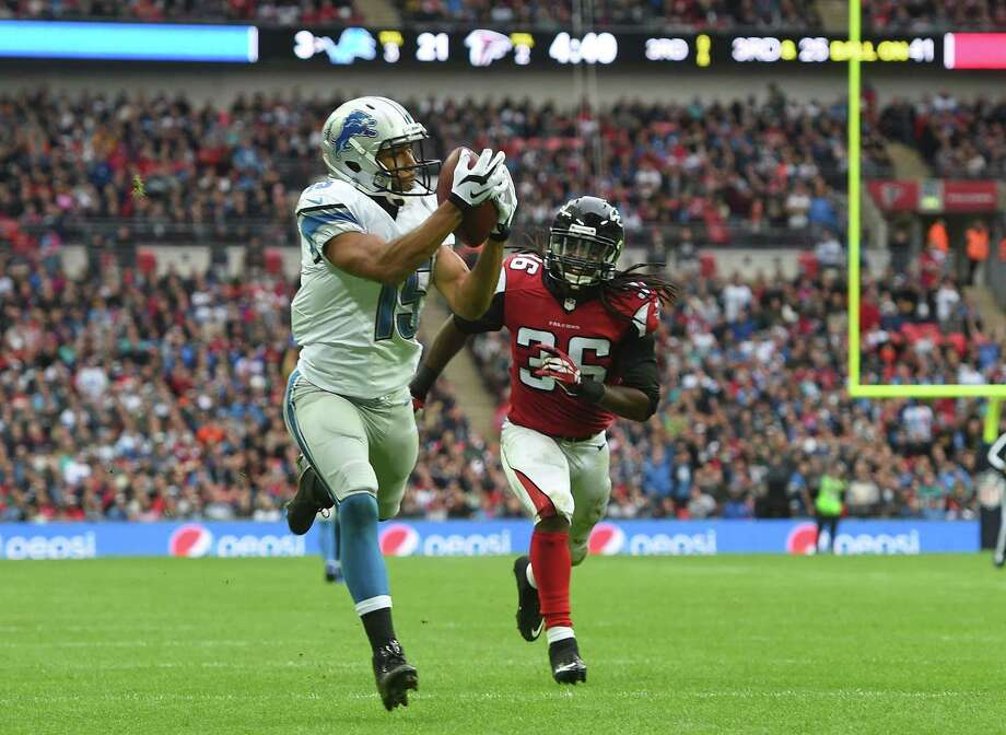 Detroit Lions receiver Golden Tate (15) catches the ball before scoring a touchdown during a game against Atlanta Falcons on Oct. 26, 2014 at Wembley Stadium in London. Photo: Tim Ireland — The Associated Press File Photo  / AP