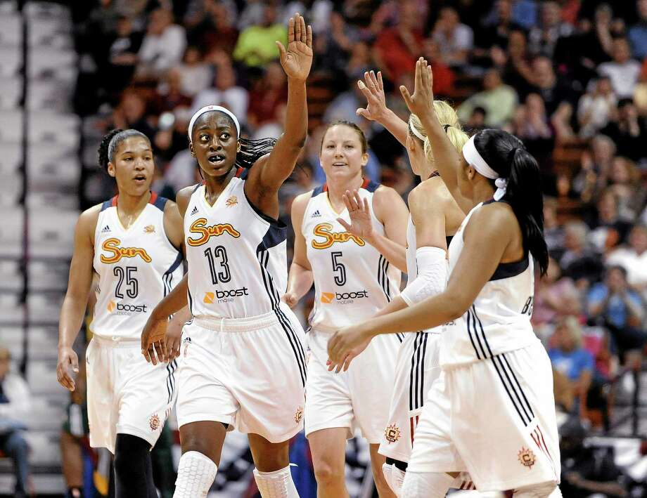 The Connecticut Sun's Chiney Ogwumike (13) reaches to her teammates for a high-five during a May 23, 2014 game against the Seattle Storm in Uncasville. Photo: Jessica Hill — The Associated Press File Photo  / FR125654 AP