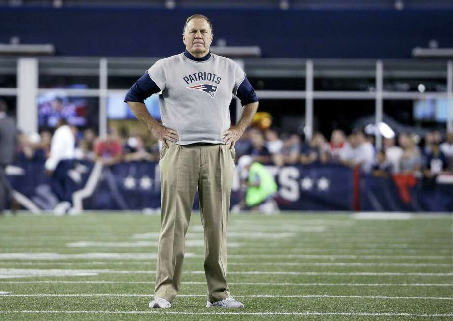 New England Patriots head coach Bill Belichick stands on the field before Thursday's win over the Texans. Photo: Elise Amendola — The Associated Press   / AP