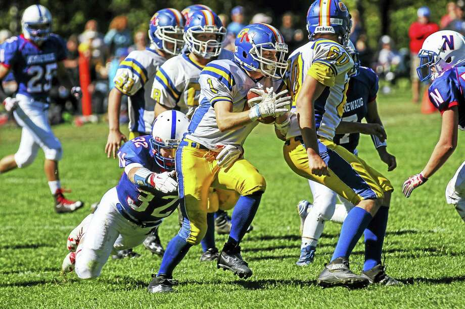 Photo by Marianne KillackeyG/N running back Billy Komons continued his assault on the Pequot Uncas-West Division with 171 yards on 10 carries Saturday afternoon at Nonnewaug High School. Photo: Journal Register Co. / 2015