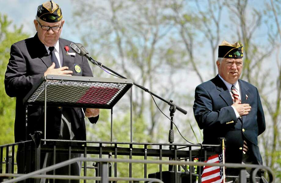 Veterans John Lilley, left, and Maj. Kevin E. Creed, right, speak the Pledge of Allegiance during a Memorial Day Parade ceremony Sunday at Bantam Cemetery's All Wars Memorial. Photo: Register Citizen File Photo