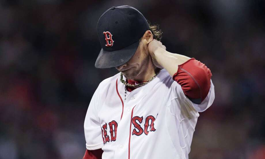 Red Sox starter Clay Buchholz rubs his neck as he heads to the dugout against the Texas Rangers in the middle of the fourth inning Thursday. The Rangers won 3-1. Photo: Charles Krupa — The Associated Press  / AP