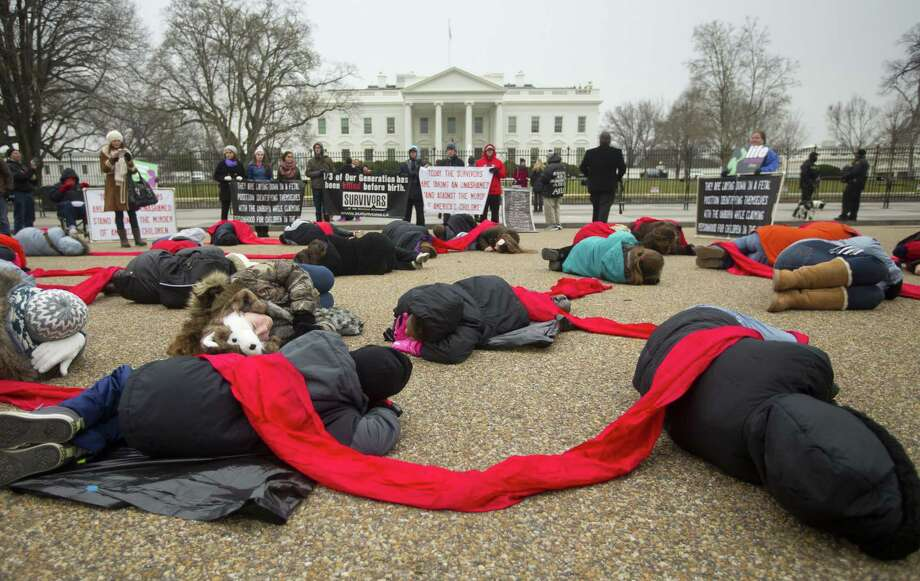 "Anti-abortion activists stage a ""die-in"" in front of the White House in Washington on Jan. 21, 2015. Thursday marks the 42nd anniversary of the U.S. Supreme Court's Roe v. Wade decision in 1973 that established a nationwide right to abortion. Photo: AP Photo/Pablo Martinez Monsivais  / AP"