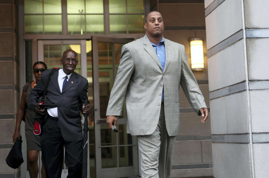 Former UConn star Tate George was sentenced to nine years in prison for his role in a real estate Ponzi scheme. Photo: The Associated Press File Photo  / The Record of Bergen County