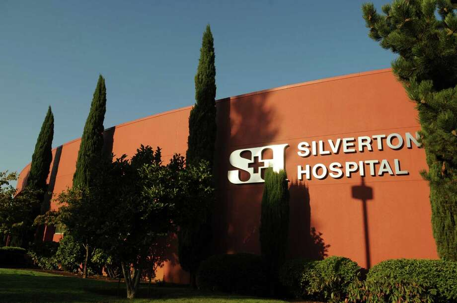 This Aug. 31, 2009, photo shows the exterior view of Silverton Hospital in Silverton, Ore. About 10 patients at the Oregon hospital suffered burns because staff didn't replace filters on lights in three operating rooms, officials at the medical center said Wednesday, Jan. 21, 2015. (AP Photo/Statesman-Journal, Danielle Peterson) Photo: AP / Statesman Journal