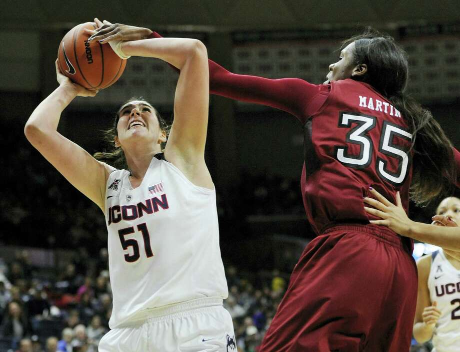 UConn's Natalie Butler is fouled as she goes up for a basket against Temple's Safiya Martin on Saturday. Photo: Jessica Hill — The Associated Press  / FR125654 AP
