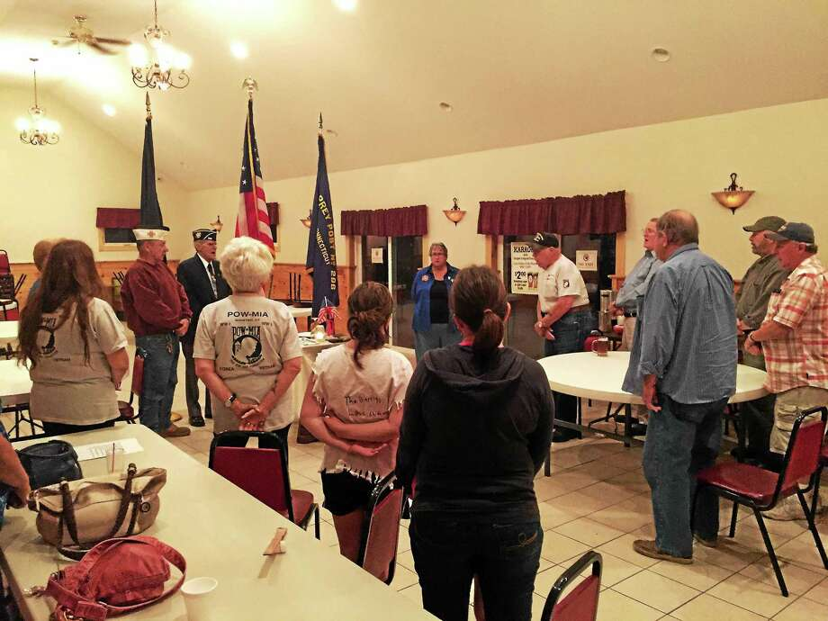 Members of Winsted VFW Post 296 and the local community gathered together Friday evening to mark National POW/MIA Recognition Day. Photo: Ben Lambert — The Register Citizen