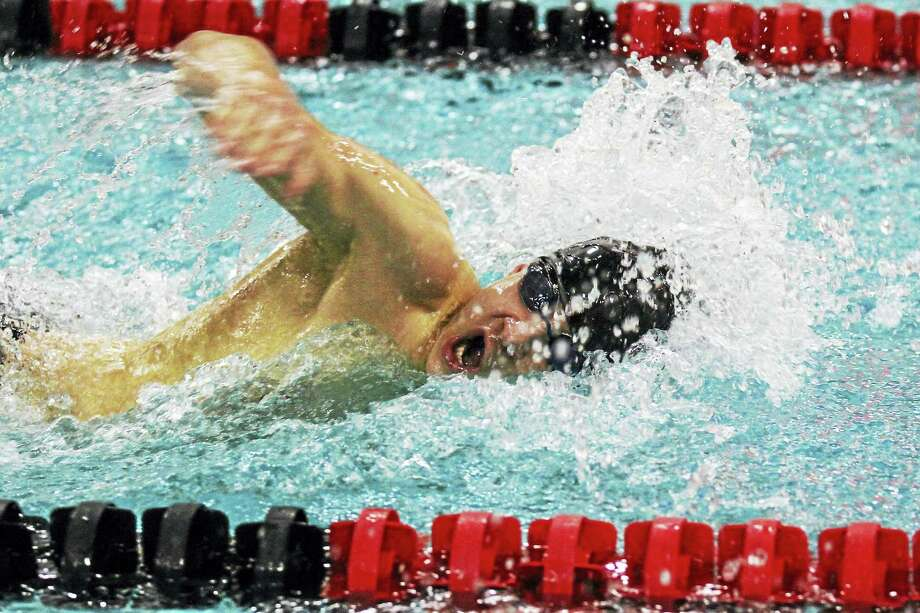 Torrington freshman Viktor Nemesvari, a winner in the 50-yard freestyle against Seymour, is part of a long trail of future competition against Wildcat underclassmen. Photo: Marianne Killackey — Register Citizen  / 2015
