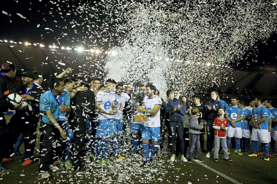 Soccer players celebrate after finishing a 120-hour match at Bicentenario stadium in Santiago, Chile. Photo: Esteban Felix — The Associated Press  / AP