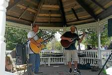 Peter Hurlbut and Kevin LeMere, both of Winsted, known as the music duo Kevin & Pete, performed classic rock and country songs at Winchester Center Day in the gazebo amid an antique car show on the Winchester Town Green at Newfield Rd. and Route 263 in Winchester on Saturday afternoon.