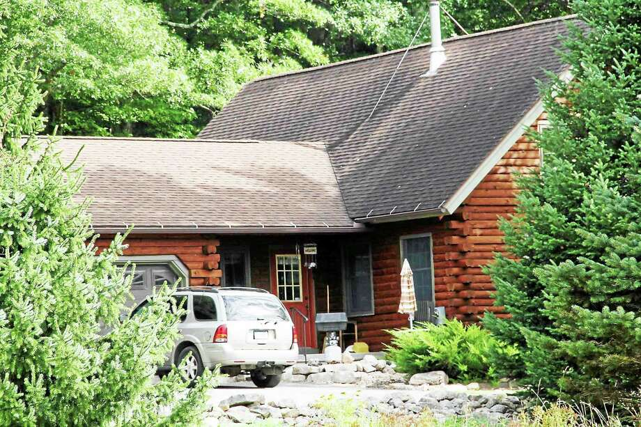 Manon L. Mirabelli| -- The Register Citizen This log home at 1 Mountain Lane in North Canaan is the site of a Sat., Sept. 19 shooting that resulted in the death of former Connecticut State Police dispatcher Brian Johnson, 55. Photo: Journal Register Co.