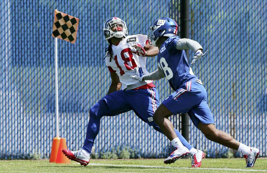 Giants wide receiver Geremy Davis (18) and cornerback Eli Apple (28) run a drill during practice on Monday in East Rutherford, N.J. Photo: Mel Evans — The Associated Press  / Copyright 2016 The Associated Press. All rights reserved. This material may not be published, broadcast, rewritten or redistribu