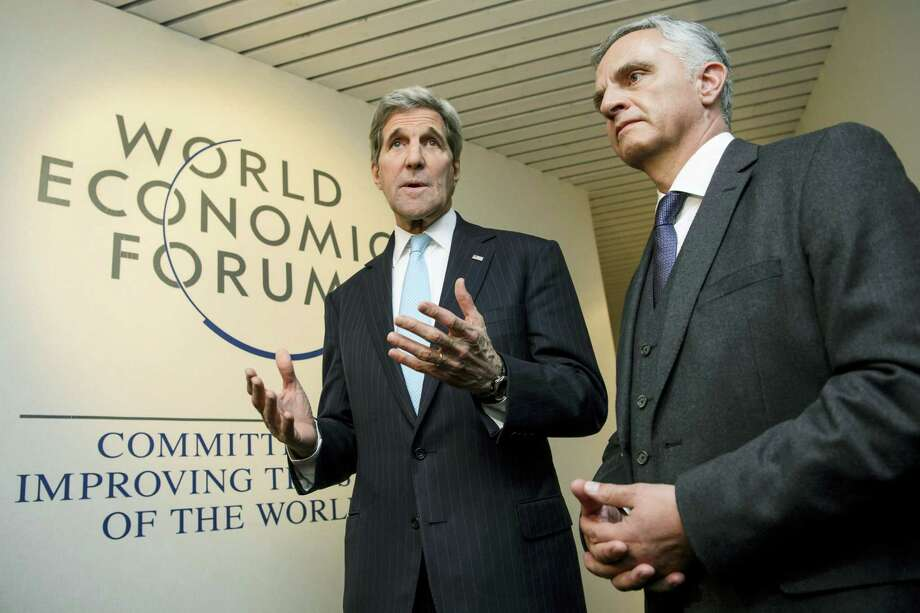 """US Secretary of State John Kerry, left, speaks to journalists with Swiss Foreign Minister Didier Burkhalter, right, during a bilateral meeting at the 46th Annual Meeting of the World Economic Forum, WEF, in Davos, Switzerland, Thursday, Jan. 21, 2016. The overarching theme of the Meeting, which takes place from 20 to 23 January, is """"Mastering the Fourth Industrial Revolution"""". Photo: Jean-Christophe Bott/Keystone Via AP  / KEYSTONE"""