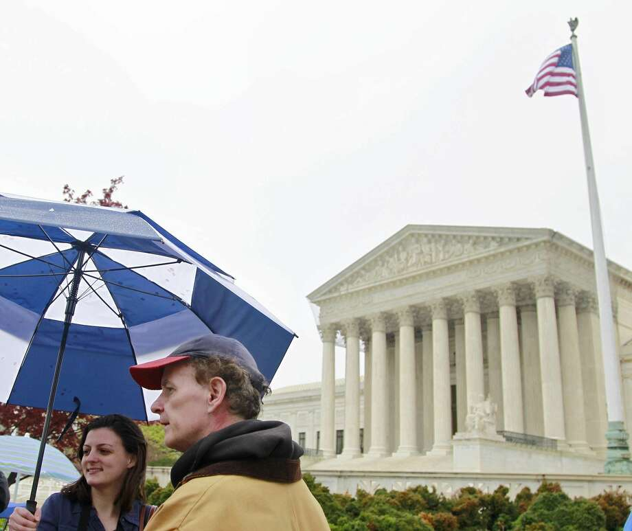 The Supreme Court in Washington, D.C., is hearing case prohibiting judicial candidates from personally soliciting campaign donations. Photo: AP File Photo  / AP2012