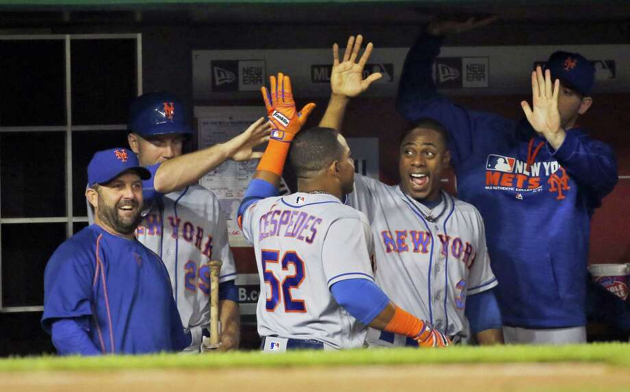 Yoenis Cespedes (52) celebrates his solo home run with teammates during the fifth inning against the Nationals Monday in Washington. Photo: Alex Brandon — The Associated Press  / Copyright 2016 The Associated Press. All rights reserved. This material may not be published, broadcast, rewritten or redistribu