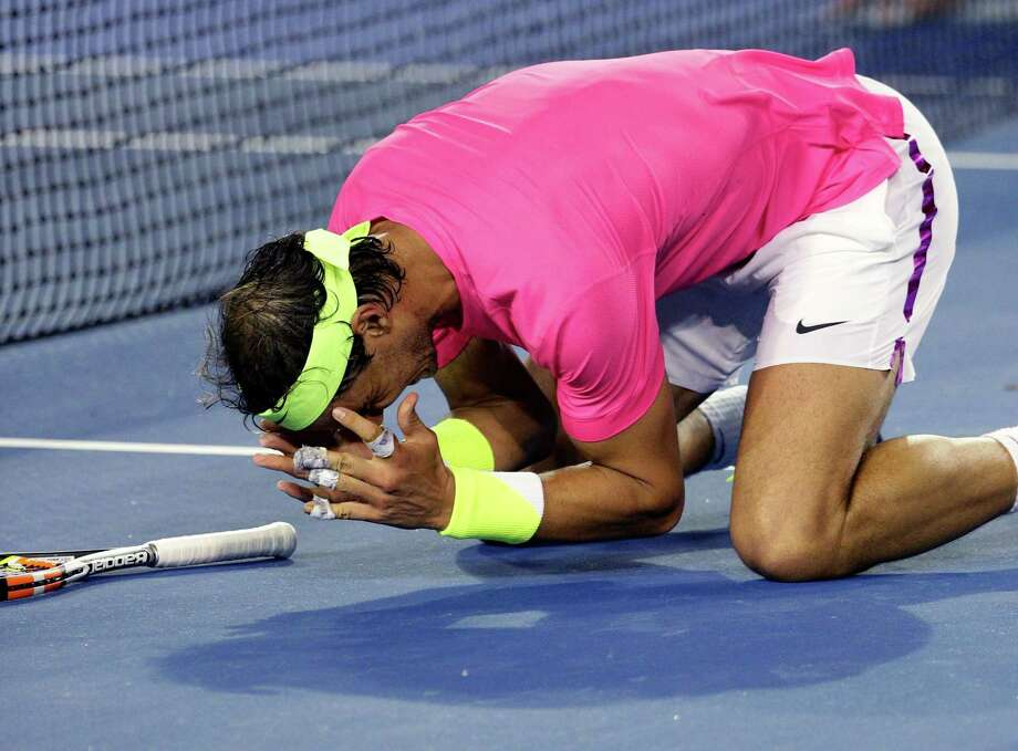 Rafael Nadal celebrates after defeating Tim Smyczek during their second-round match at the Australian Open on Wednesday in Melbourne. Photo: Rob Griffith — The Associated Press  / AP
