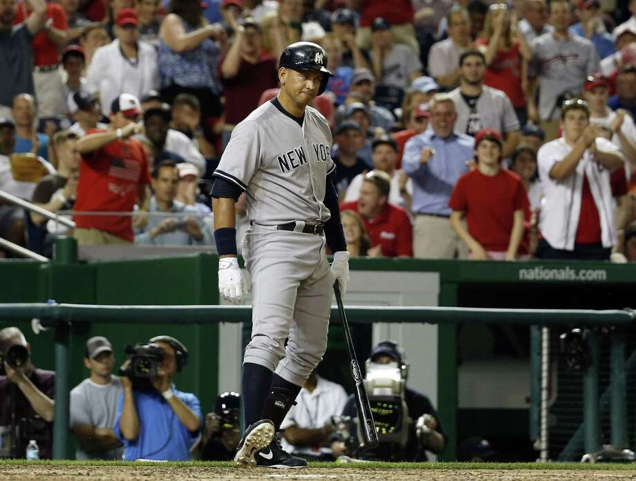 The New York Yankees' Alex Rodriguez reacts after striking out in the ninth inning of Tuesday night's game against the Nationals in Washington. Photo: Alex Brandon — The Associated Press  / AP